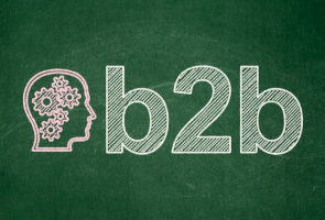 illustration of a head and letters b2b on green blackboard