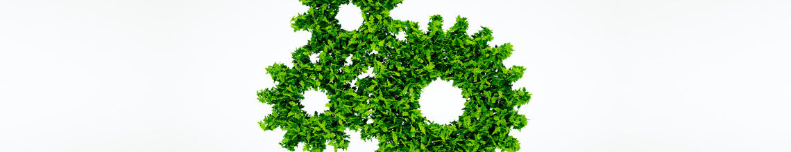 Three interlocking cogs made of green foliage